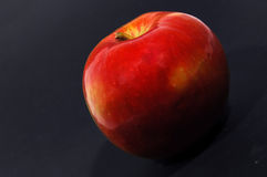 Red apple #2. Red apple on black background royalty free stock photos