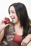 Red apple 2. Brunette eating a red apple stock image