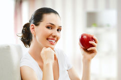 Red apple. A beautiful girl eating apple royalty free stock photo