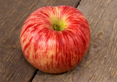 The red apple. The red apple laying on wooden boards Royalty Free Stock Photos