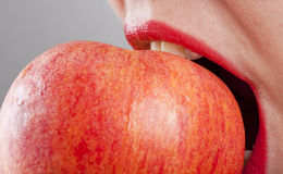 Red apple. Woman eating a red apple Stock Photo
