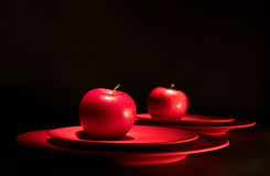 Red apple. Apple reflects in a mirror Stock Photos