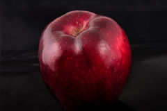 Red apple. On a black background Royalty Free Stock Photography