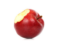 Red apple. With a bite missing, white background Royalty Free Stock Photo