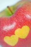 Red apple. With two hearts Stock Photography