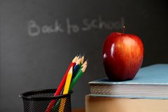 Red apple against black board Stock Image