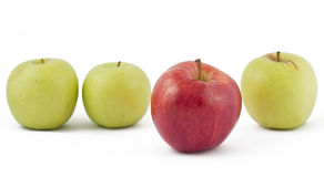 Red apple ahead of the green on white. Background Stock Photo