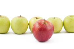 Red apple ahead of the green on white. Background Royalty Free Stock Images