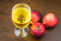 Red apple and apple juice Stock Photos