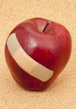 Red Apple with Bandaid Royalty Free Stock Images
