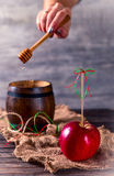 Red Apple and a barrel with honey Stock Photo