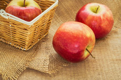 Red apple and basket, filtered image Stock Photography