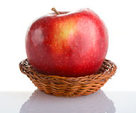 Red apple in basket with reflection Stock Image