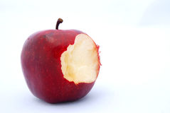 Red apple bite. A big red apple with one bite taken. Image isolated on white studio background Stock Photos