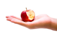 Red apple with a bite missing on hand Royalty Free Stock Images