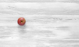 Red apple on black and white wood background Stock Photos