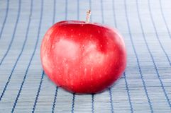 Red apple on blue background Stock Photo