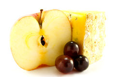 Red Apple, Blue Cheese and Grapes. Sliced red apple with slice of blue cheese and grapes with clipping path on a white background Royalty Free Stock Image