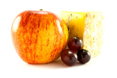 Red Apple, Blue Cheese and Grapes. Single red apple with slice of blue cheese and grapes with clipping path on a white background Stock Photos