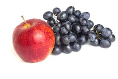 Red apple and blue grapes on white background royalty free stock photo