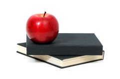 Red apple on a book Royalty Free Stock Image