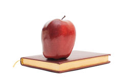 Red apple on the book Royalty Free Stock Photography