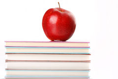 Red apple on a book Stock Image