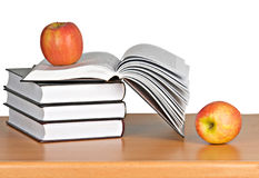 Red apple on book Stock Photos