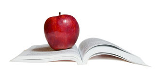 A red apple on  book Royalty Free Stock Photos