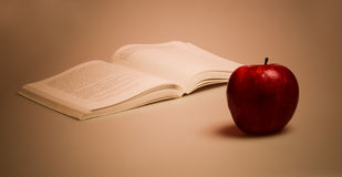 Red apple and book. A red apple and book Stock Images