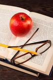 Red apple and book Royalty Free Stock Image