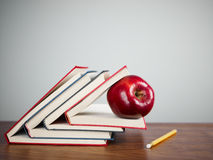 Red apple on books Stock Photo
