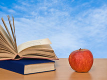 Red apple and books. On desk Royalty Free Stock Photography