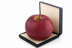 Red apple in box isolated Royalty Free Stock Image