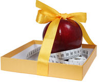 Red apple in box with tape-line like gift Stock Photo