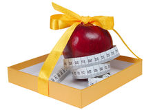 Red apple in box with tape-line like gift Stock Photography