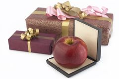 Red apple in box and two gifts boxes Stock Photo