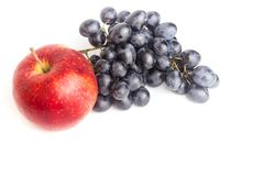 Red apple and blue grapes isolated on white background stock image