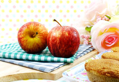 Red apple, cake coffee flavor and milk. On sweet polka dot background royalty free stock photos