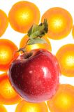 Red Apple on Carrot Background Stock Photos