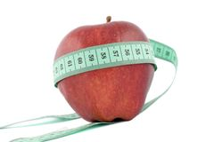 Red apple with a centimeter Royalty Free Stock Image
