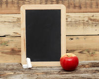 Red apple on chalkboard Stock Images