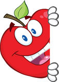 Red Apple Character Hiding Behind A Sign Stock Images