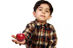 RED APPLE IN CHILD HAND Royalty Free Stock Photo