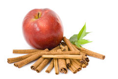 Red apple and cinnamon. On white Royalty Free Stock Images