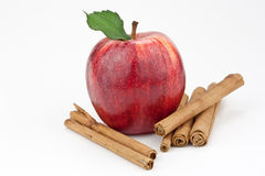 Red apple and cinnamon Royalty Free Stock Photos
