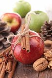 Red apple and cinnamon. Walnut Royalty Free Stock Image