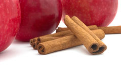 Red apple and cinnamon. On white background Royalty Free Stock Photography