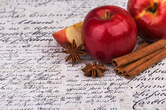 Red apple with cinnamon. And anise stars Stock Photo