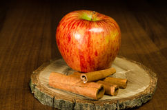 Red apple with cinnamon. Decoration Royalty Free Stock Images